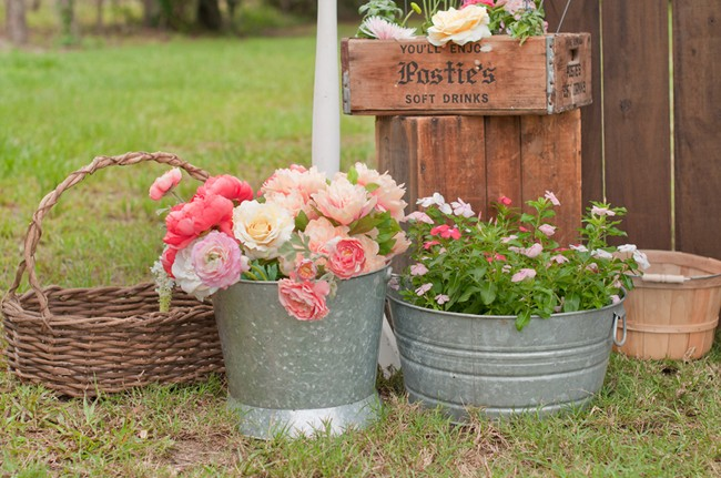 Flower stand engagement session flowers in buckets and baskets