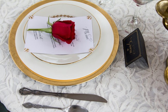 Gold charger plate with a red rose on a lace table cloth in Balboa Park