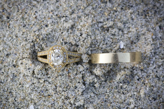 gold diamond engagement rings on sand