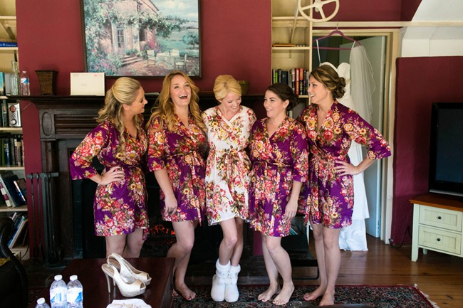bride and bridesmaids wearing the same house coat at Sweetwater Farm Grace Winery