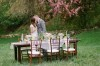 bride and groom standing infront of breakfast table in the countryside