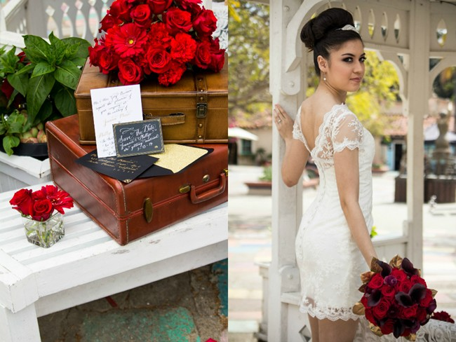 bride holding red roses with vintage suitcase and black and gold invitations  in balboa park