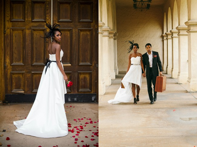 bride holding vintage suite case in Balboa Park with rose petals on the ground wearing  Iselle Design Studio1 walking with groom