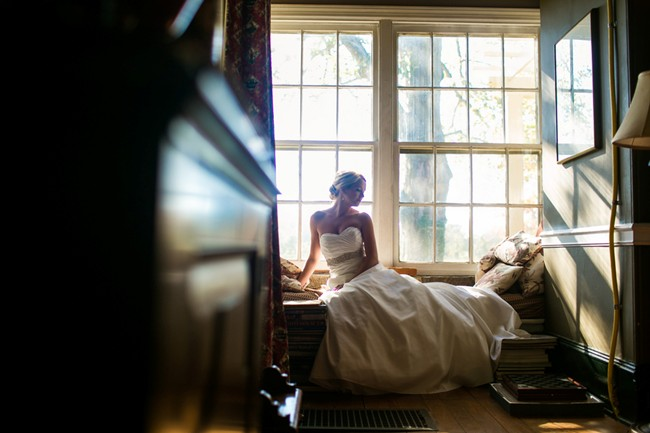 bride sitting on window steal