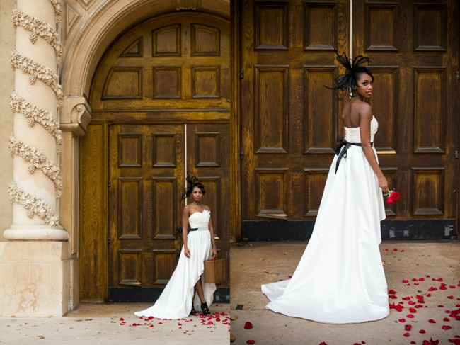 bride wearing  Iselle Design Studio in balboa park in front of big wood door holding vintage suite case