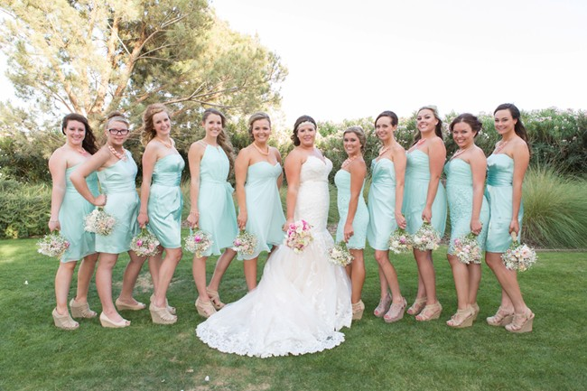 bride with bridesmaids in blue dreses at Classic Club