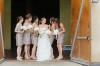 bride with bridesmaids stading infront of barn door at montaluce winery