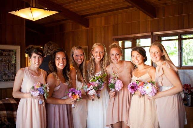 bride with bridesmaids wearing pink and purple sheer dreses  captured by aubrey joy photography