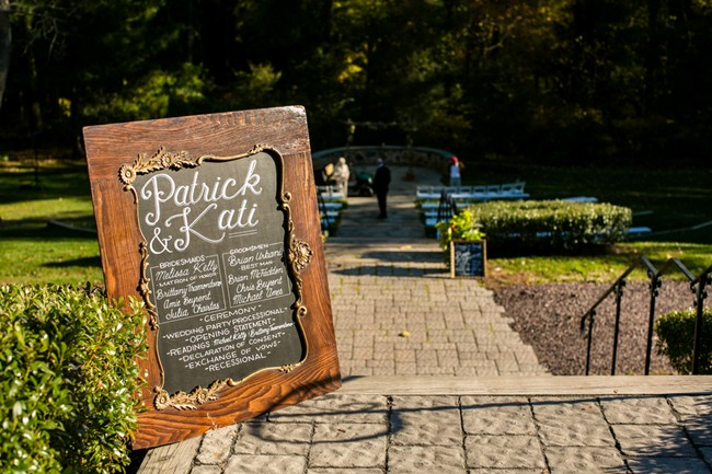 chalk board sign at wedding ceremony