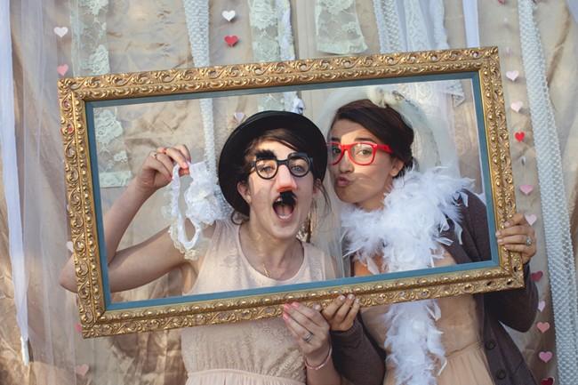 girls dressed up in wedding photobooth  captured by aubrey joy photography