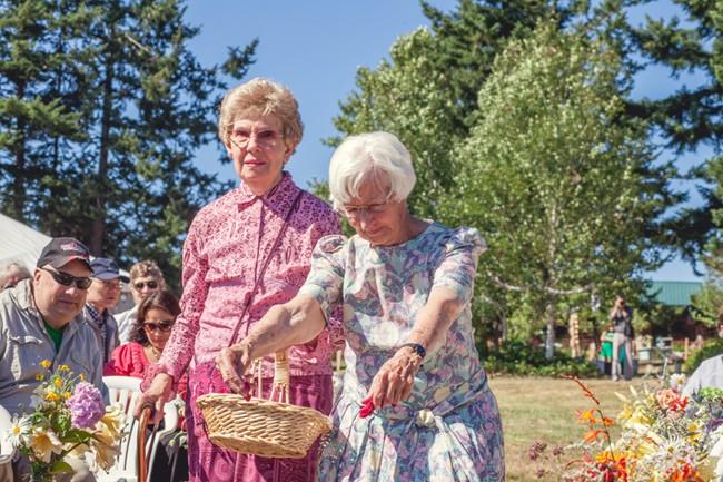 grandmother as flower girls during wedding ceremony  captured by aubrey joy photography
