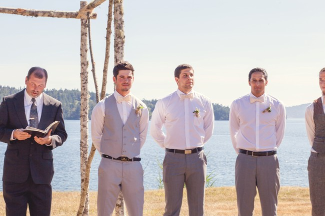 groom and groomsmen wearing grey waiting at the altar captured by aubrey joy photography