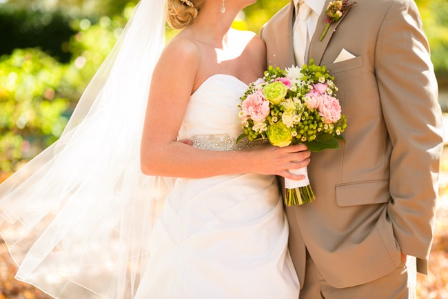 pink green wedding bouquet bride and groom