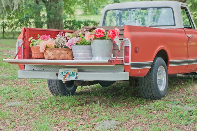 red ford truck with buckets of flowers