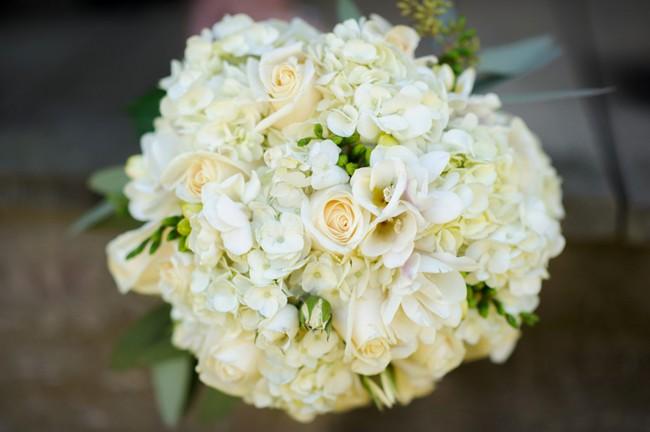 white hydrangea and white rose wedding bouquet