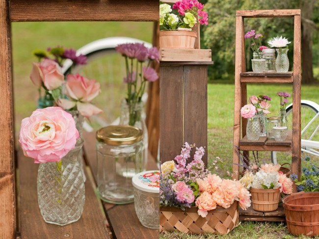 wooden shelf with flowers in glass containers