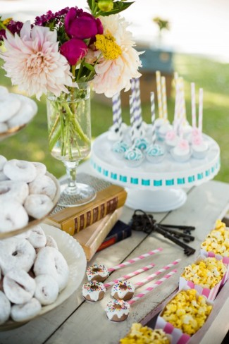 wedding dessert table with popcorn and white powder mini donuts