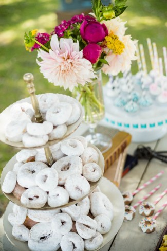 3-tier white powder mini donuts on wedding dessert table