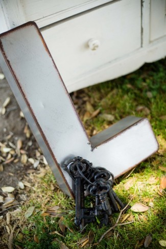 """engagement shoot - giant wooden """"L"""" with vintage keys"""