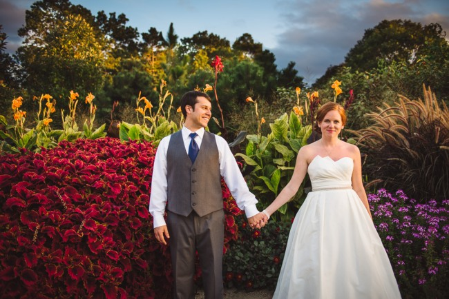 Bride and Groom holding hands at North Carolina Arboretum
