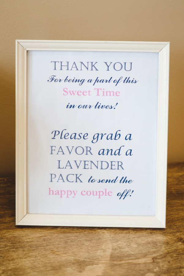 Pink and navy blue thank you sign at wedding reception  at North Carolina Arboretum
