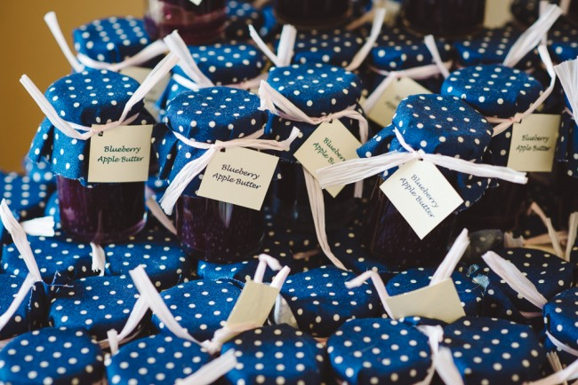 blue berry apple button in jar with navy blue and white polka dots  at North Carolina Arboretum wedding reception