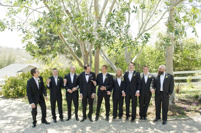 10 groom with groomsmen wearing black tux with rainbow bow tie