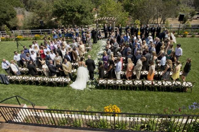 13 bride and father walking down aisle in backyard wedidng ceremony