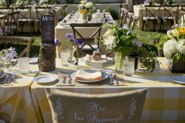 24 wedding reception with yellow white and purple wild flowers and yellow and white table cloth