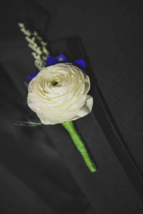 White flower boutonniere with blue ribbon  at North Carolina Arboretum