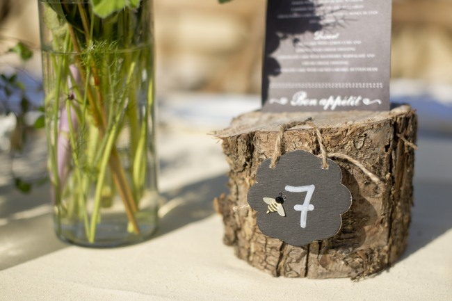 27 wedding reception wooden stump with chalkboard table number