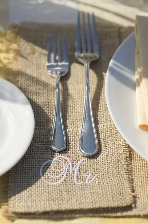 31 outdoor wedding reception with burlap place setting with Mr stiched on it