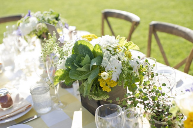 32 white green and yellow wild flowers in square vase at wedding reception