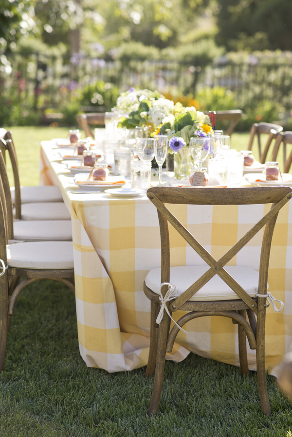 32 yellow and white table cloth in backyard wedding reception