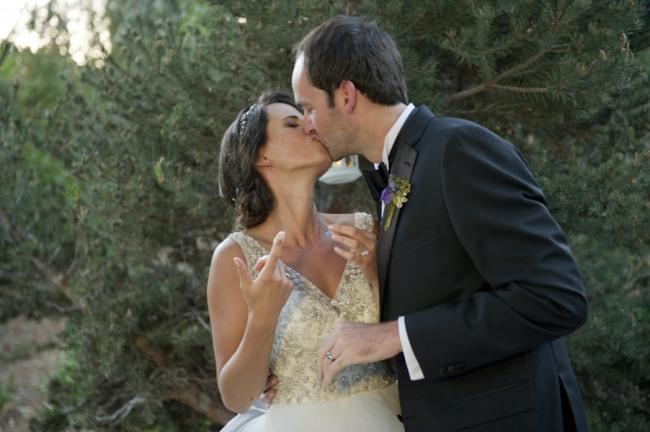 38 bride and groom in backyard wedding eating wedding cake
