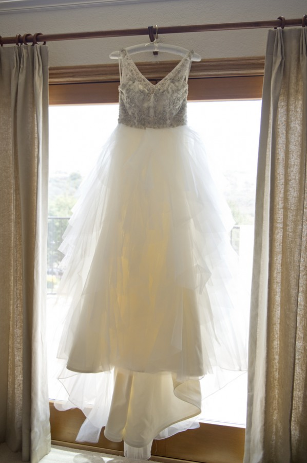 5 white wedding dress with beaded body with straps and a low v in the back