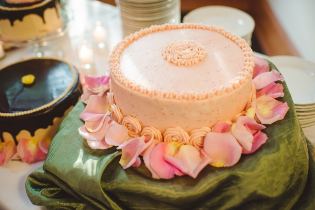 Pink cake with pink rode petals  at North Carolina Arboretum