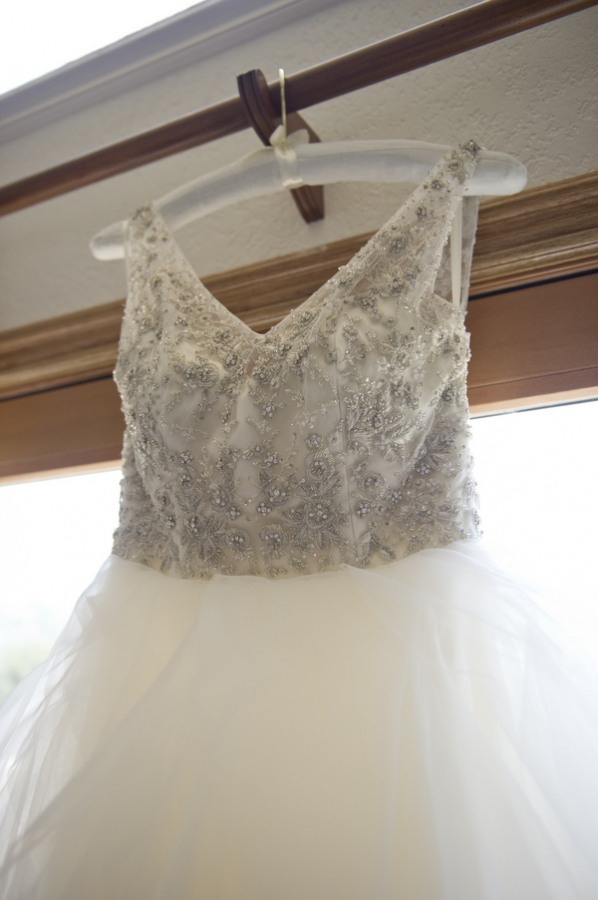 6 white wedding dress with beaded body with straps and a low v in the back