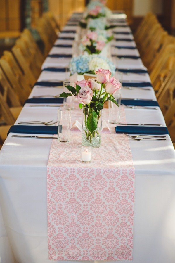 Navy blue and pink wedding reception  at North Carolina Arboretum  with pink roses