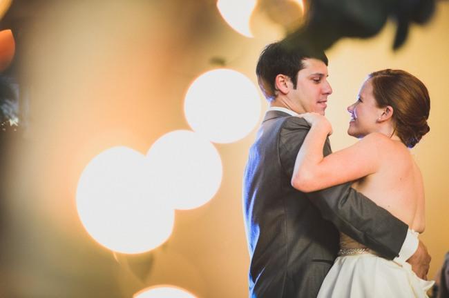 bride and groom dancing  at North Carolina Arboretum
