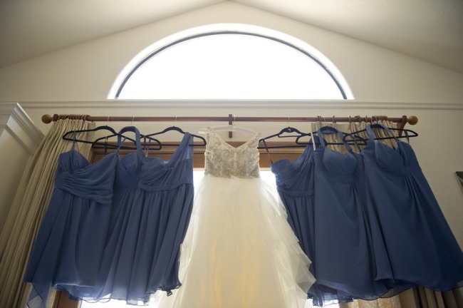 7  white wedding dress with beaded body with straps and a low v in the back and blue short bridesmaids dresses