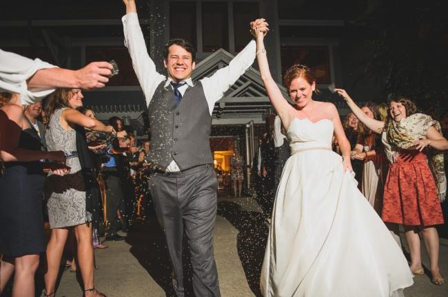 Bride and groom leaving wedding reception  at North Carolina Arboretum