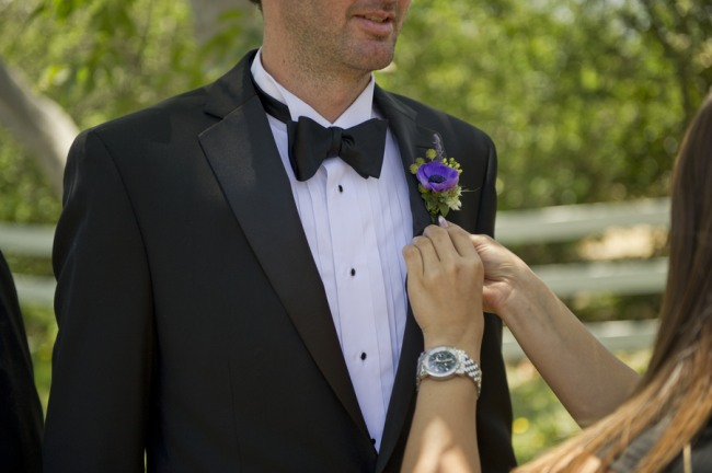 9 Groom wearing black tux and blue boutoniere