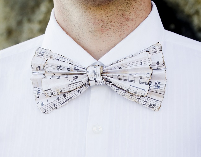 Groom wearing a musical note patterned bow tie