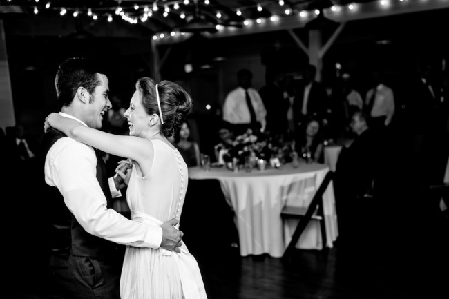 Black and white photo of bride and groom dancing at Palm Door venue