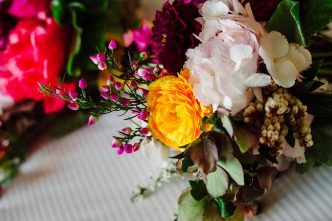 dahlias, anemonies, peonies, marigolds, wild roses bridal bouquet   at Palm Door