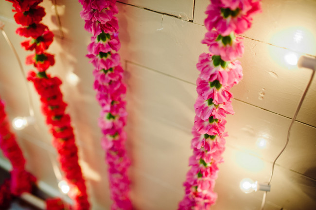 Red pink flower ceremony backdrop at Palm Door venue