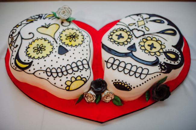 Day of the dead themed wedding cake at  Palm Door venue, skulls wedding cake