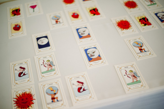Day of the dead themed wedding table place cards at  Palm Door venue