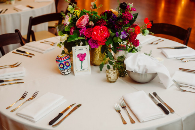 Day of the Day themed Wedding reception at Palm Door with pink yellow green flowers  with paper mache skull